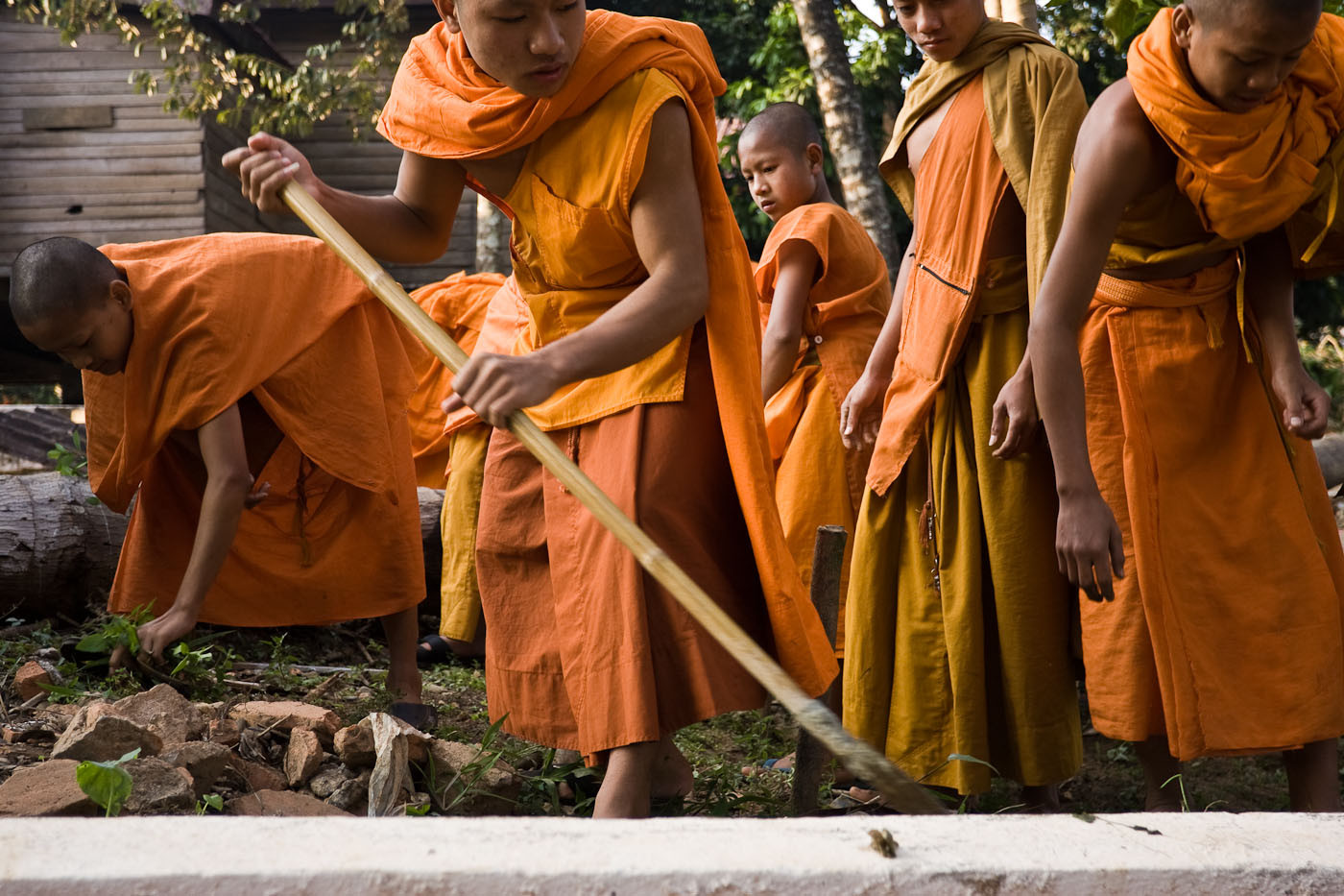 Monks do morning work in Vang Vieng, Laos