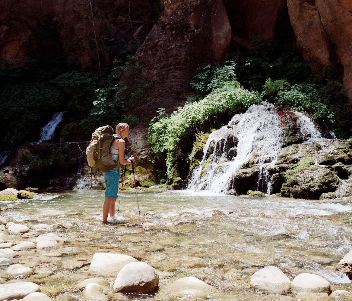Emily Ayres at a waterfall in the Narrows in Zion National Park, Utah