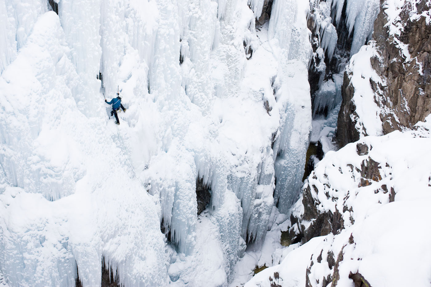 Male ice climber (Aaron Prochaska) climbing in Ouray, Colorado