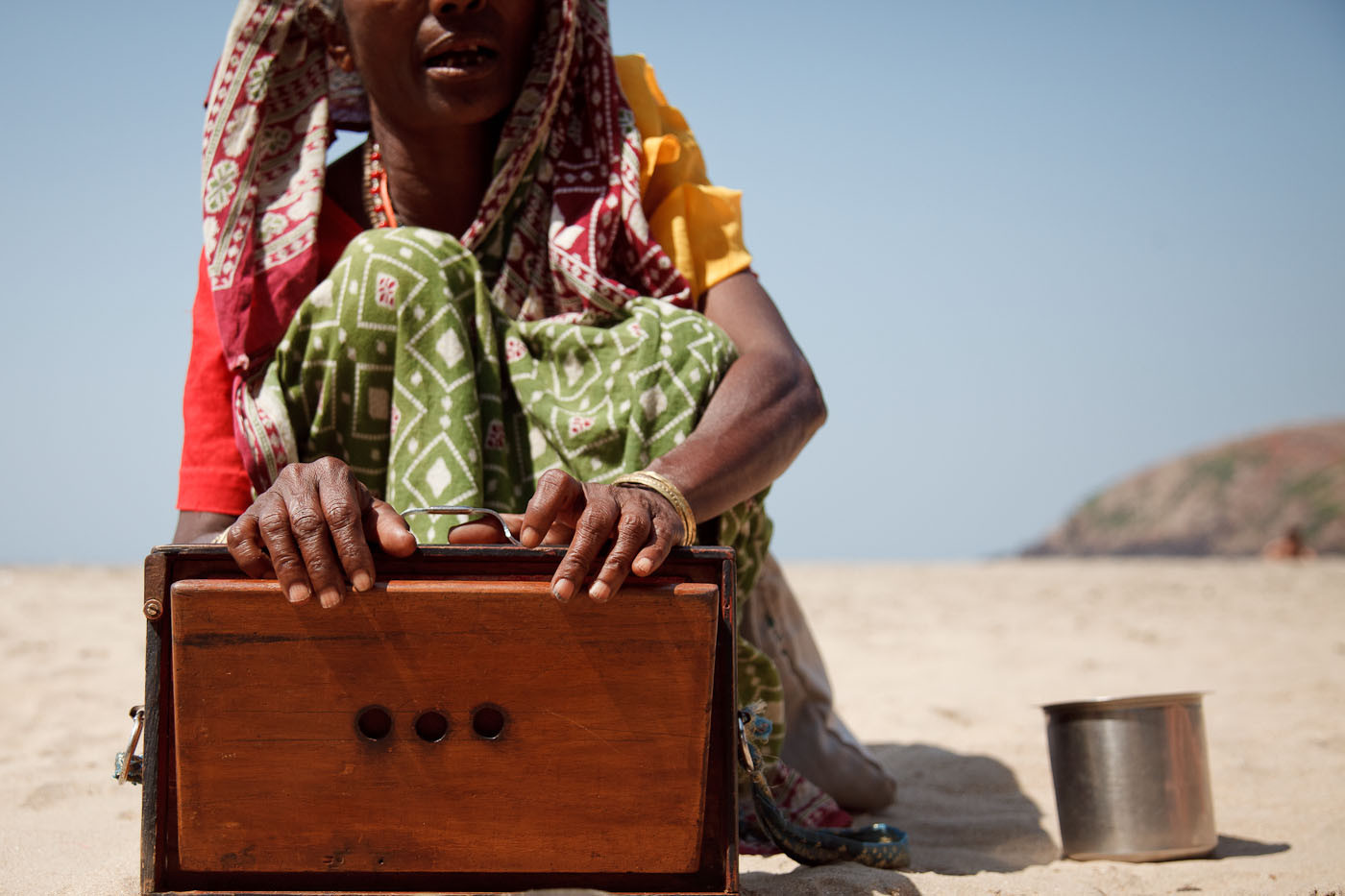 Indian woman singing on the beach for money in Gokarn, India