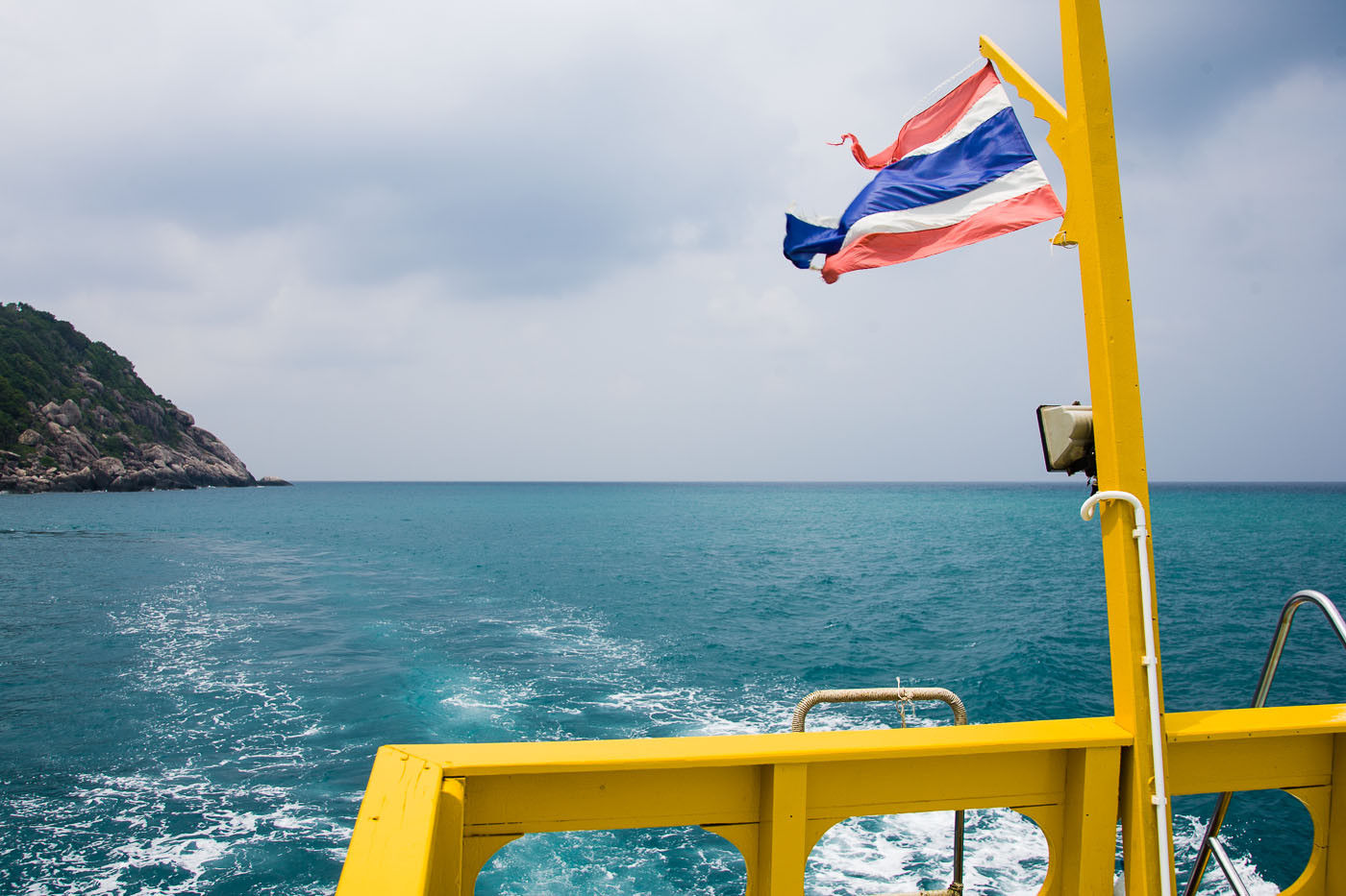 Stern of dive boat and flag near Koh Tao, Thailand