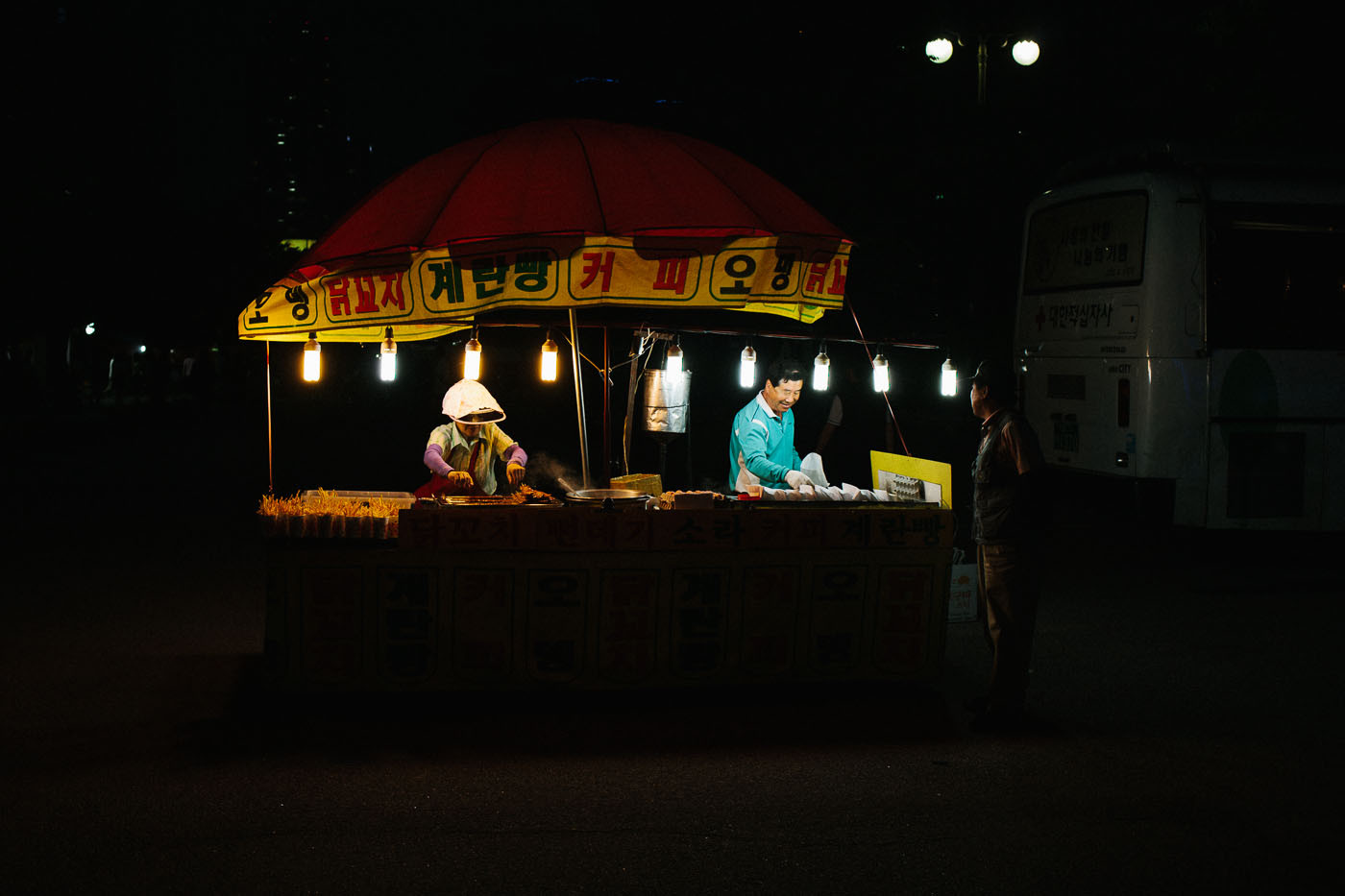 Food vendors at night in Seoul, South Korea