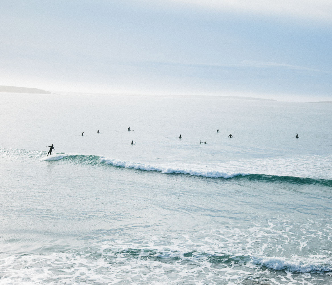 A lineup of surfers in Baja, Mexico
