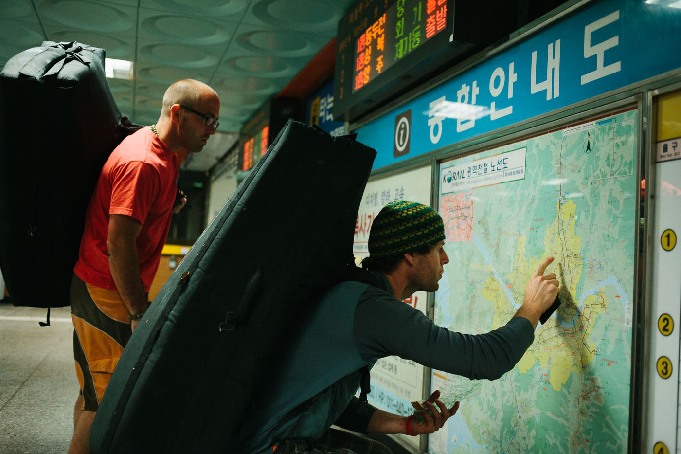 Paul Lammens and Dave McAllister check a subway map in Seoul, South Korea