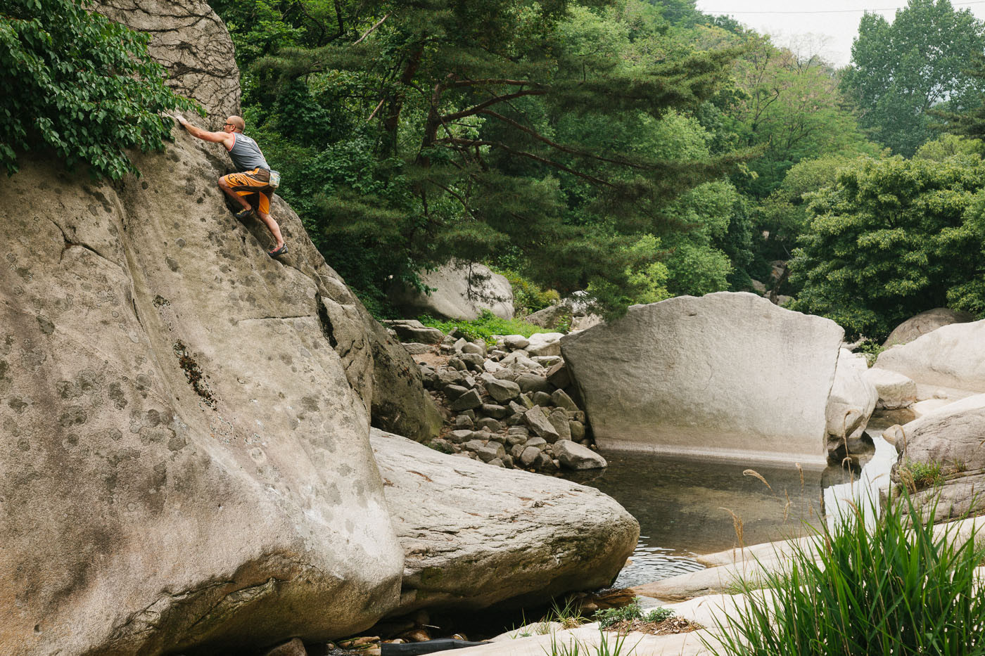 Dave McAllister climbs Vertical Twister at the Riverbeds in Bukansan National Park, South Korea